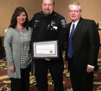 Pictured Tina Scheuerman, Patrolman Ken Scheuerman, and Mayor Don Atkinson