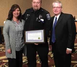 Pictured Tina Scheuerman, Patrolman Ken Scheuerman, and Mayor Don Atkinson
